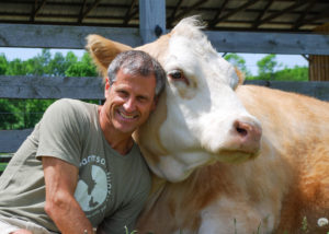 Gene and Cow Living the Farm Sanctuary Life